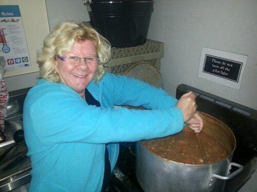 Lyn stirring the stew