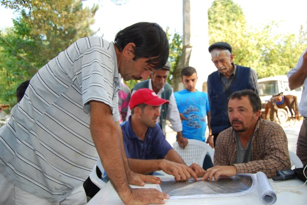 Thinking about our Route along the way: Ercihan confers with locals, 2009.